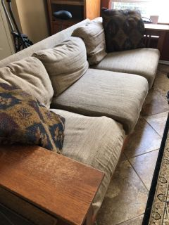 2 identical couches and an exercise bike for free