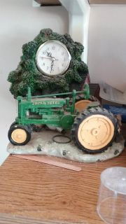 Cast iron and ceramic John Deere clock decor Great condition awesome condition great Christmas gift