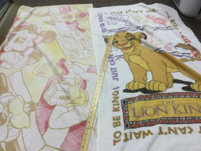 Scroll right for more photos, Disney Mickey, Minnie, Donald, Goofy pastel beach towel and Lion King beach towel, $2.00 for both.
