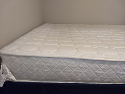 King size bed with foldable bed frame and pillows