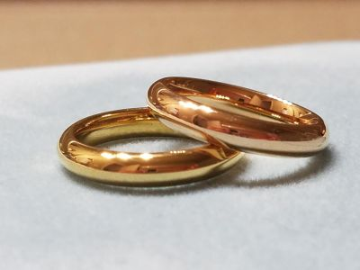 GORGEOUS 2 PACK OF GOLDEN RINGS, SIZE 7, STAINLESS STEEL, WILL NOT TARNISH