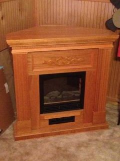 Wood tv stand $50 and electric fireplace $100