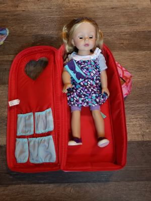 """18"""" doll, carrying case, and 5 outfits"""
