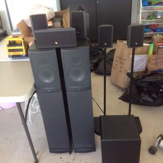 Infinity surround system including floor standing speakers and subwoofer, works excellent