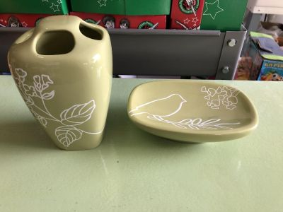 Toothbrush holder and soap dish.