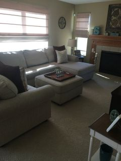 Three piece cream sectional with ottoman