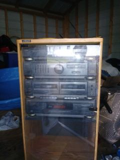 5 cd player with double tape player two large speakers. Works Great