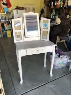 Wood vanity with photo frames