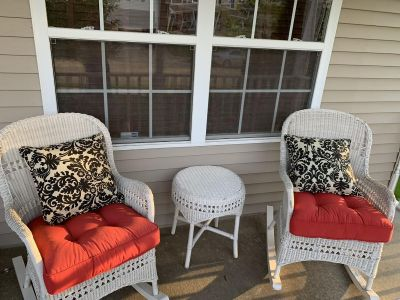 White wicker rocking chairs and (red) base cushions (Pier 1)