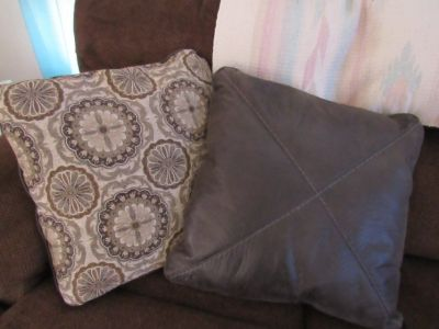 2 Large couch pillows brown and other side brown leather very nice
