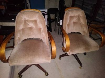 2 vintage rolling dining chairs