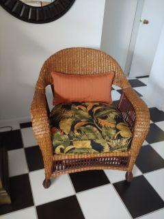Wicker chair with custom seat and throw pillow