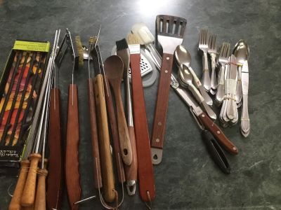 BBQ tools and cutlery mostly forks knives spoons