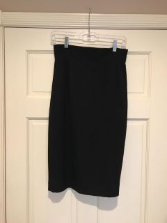 Black, wool pencil skirt by Anne Klein ll. Excellent condition.