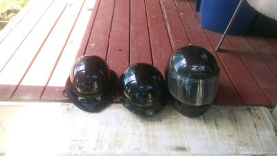 Three motorcycle Helmets