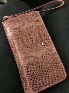 Small pink wallet. Good condition.