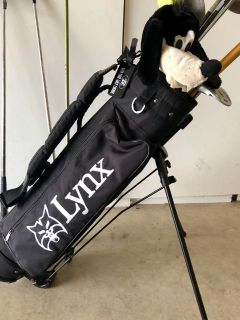 Youth golf bag and clubs.