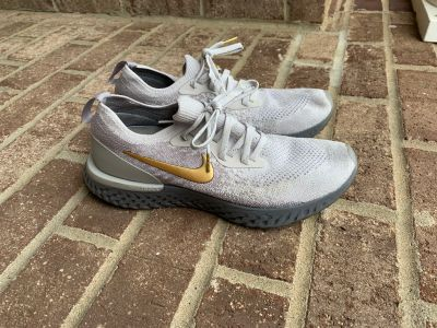 Worn Once and Freshly Laundered NIKE EPIC REACT Fly Knit Vast Grey Metallic Gold Tennis Shoe / Sneakers Women s Size 9.5 so comfy on!