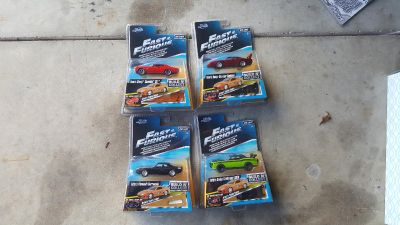 New in package 4 fast & furious build n collect toy cars