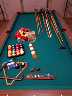 nice pool table and accessories!