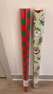 two rolls of christmas wrapping paper