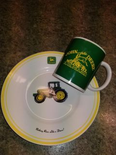 """John Deere 9"""" lunch plate and coffee cup, cup has small chip on bottom but hardly noticeable, used for party decorations, dish washer safe"""