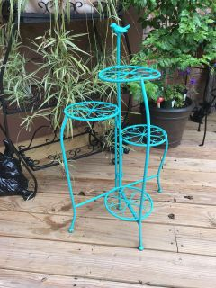 4 tire Plant Stand in plastic power coating in Teal.