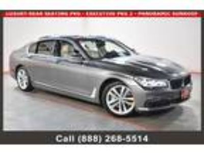 $42055.00 2016 BMW 750i with 52333 miles!