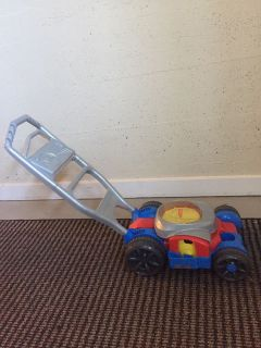 Fisher Price lawn mower (blows bubbles)
