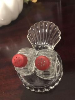 Antique salt and pepper shakers. With tray. 1-1/2 tall.