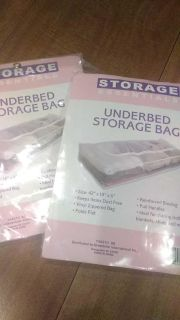 Two new under bed storage bags, one is open to view....did not work for me