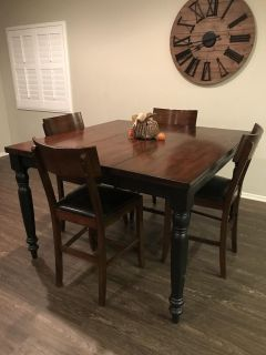 Expandable wooden pub table with four chairs