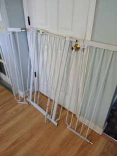 Tall pet gate with small door