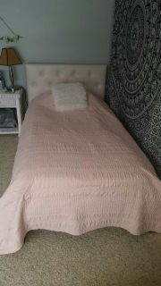 Peachy pink (rose gold) twin quilt from Target. Haven't had very long. Excellent condition. Very clean.