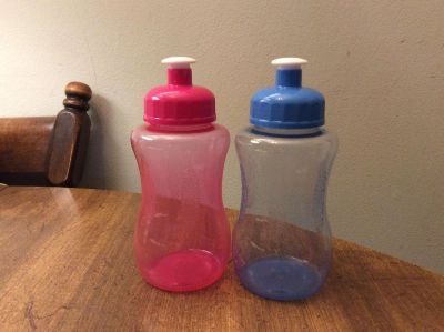 2 Refillable Water or drink bottles with pop up tops. Great size for the kids. Holds 10.5 Oz.