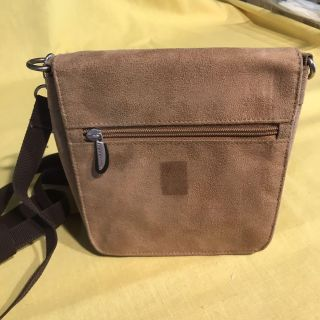Brown leather cross body purse by Travelon.
