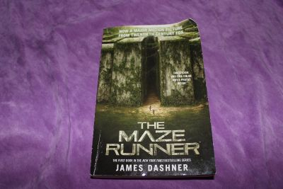 The Maze Runner (Paperback) by James Dashner. Included in book is fan sticker and full color movie photos