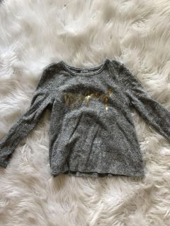 Worn once cat and Jack really soft knit material. Says magical in gold