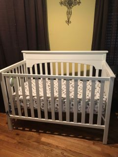 Baby bed white in color