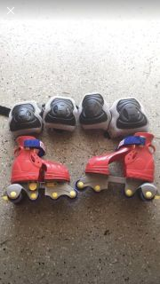 Fisher price roller skates and pads. Keep your shoes on with these!