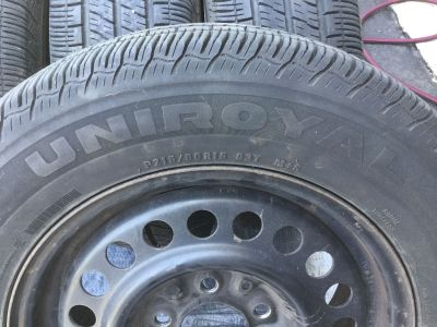 4 Uniroyal Tiger paw 215-60-15 all season tires on GM rims. Excellent condition