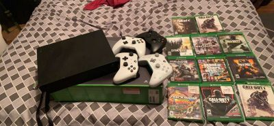 Xbox one X , games , and brand new 32 inch Visio smart TV