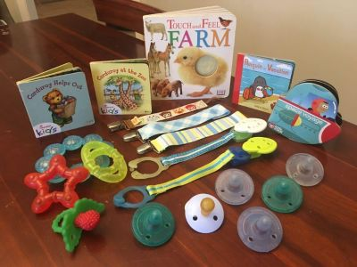 Lot of pacifiers, pacifier clips, teethers and books