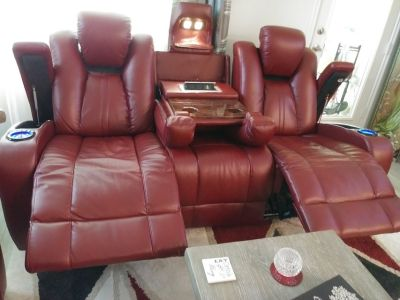 Red sofa with two recliners in it