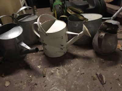 Antique tin water cans