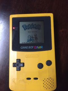 Gameboy color with Pok mon game and screen light magnifier