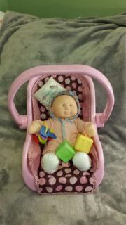 Baby doll with carry along car seat. Also has a ring of keys, pillow and 2 blocks.