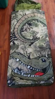 Alligator sleeping bag with inflatable insert. Never used