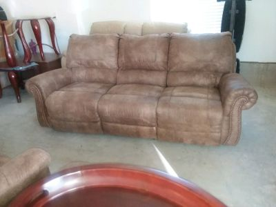 Reclining sofa with two rocker recliners