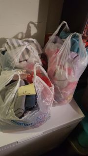 3 plastic bags of girl clothes size 24 month and 2t